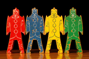 4 vintage wooden clowns in different colors
